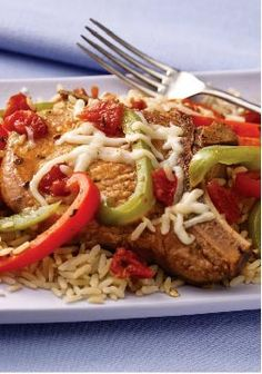 30-Minute Italian Pork Chop Dinner – Diced tomatoes, shredded mozzarella and crushed oregano leaves give this 30-minute rice and pork chop dinner its Italian-style appeal. 30minut italian, cook, brown rice, pork chop dinner, drink, dinners, italian pork, meal, pork chops