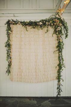 Beautiful ruffled backdrop draped with fresh floral garland. Cedarwood | Cedarwood Weddings