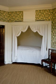 The guest bedroom which was frequented by James and Dolley Madison, complete with wallpaper which was brought back by Jefferson from France.