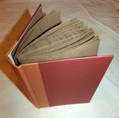 Make a journal or scrapbook out of paper bags and an old hardbook. (BOS idea)