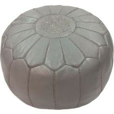 "Handmade Moroccan leather pouf with silk thread embroidery.   Product: OttomanConstruction Material: LeatherColor: Dark greyDimensions: 14"" H x 20"" Diameter"