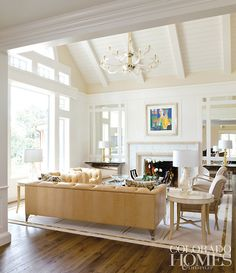 layered neutrals, pitched ceiling, mirrored wall panels