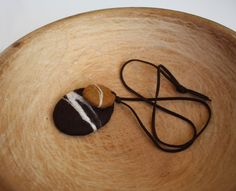 Felted pebble necklace....beautiful.
