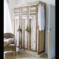 Shabby wardrobe with shutters for doors.