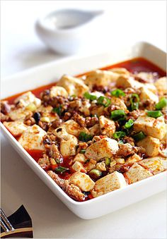 Mapo Tofu Recipe - The Mapo Tofu recipe is not for the faint-hearted, it's lip-smackingly spicy and downright incendiary #pork #tofu #chilis