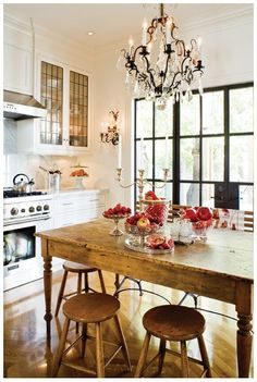 A rustic, classic, and cozy country kitchen features a vintage farmhouse table for in-room dining