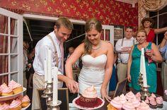 Cutting the red velvet wedding cupcake... Sweet congratulations, Kari & Ben! | photo credit Priscilla Thomas Photography #weddingcupcakes #cupcakedownsouth