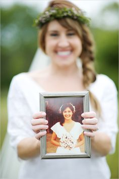Bride holding her mother's wedding photo. In love with this idea!