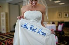 The bride had her married name sewn in under her dress as her something blue.