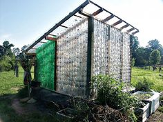 Plastic bottle greenhouse on Blue Rock Station, Ohio...bluerockst... (info below*) This one sits on old tires and is made from 1000 2-liter plastic soft drink bottles.