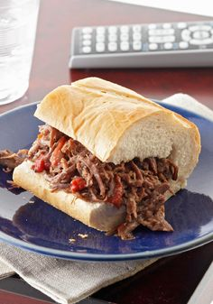 Italian Beef Sandwiches -- Roasted peppers and slow simmering are the keys to a shredded beef sammy recipe that rivals the hot, delicious fare of a big-city deli.