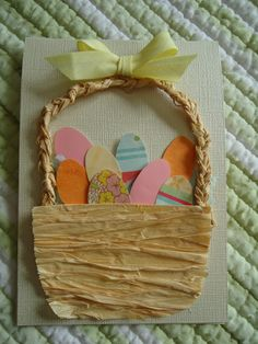 handmade easter card- rafia basket with paper eggs and yellow bow - so cute!!