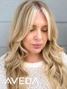 What takes a sandy blonde balayage to the next level? Icy cool face framing highlights. We can't wait to see more of these bright, bold platinum highlights showing up as a hair color trend for fall 2020. To style these loose waves on long hair, Aveda Artist @juanmorecut.salonblond used Cherry Almond Leave in To help soften and detangle, Damage Remedy Daily Hair Repair, Heat Relief, Texture Tonic & Air Control. Click the products get the look or tap to learn more about damage-free Aveda color.