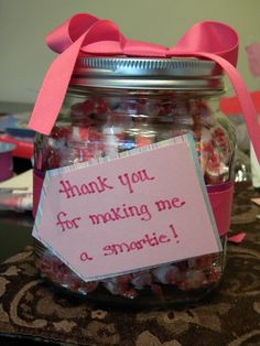 "super simple teacher gift.  glass jar with Smarties candy inside and a little note, ""thank you for making me a Smartie."""