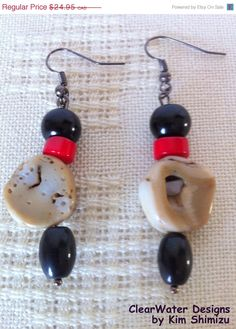 Gun Metal Dangle Earrings, Natural Coral by ClearWaterDesignsbyK, $14.97,These Gun Metal Dangle Earrings feature Natural Coral Freeform Slab Beads, Black Agate Beads, Red Coral Heishi Beads & Black Glass Pearl Beads.  Coral freeform slab beads retain the naturally formed texture and rough look of its original state, therefor no 2 beads are alike in shape, texture & colour. They have been polished for a smooth finish. http://www.clearwaterdesigns.info