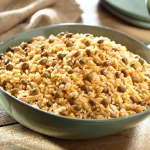 Rice with Pigeon Peas and Coconut also known as Moro de Guandules con Coco. Enjoy the tender grains of rice mixed with plump pigeon peas. This recipe catches the essence of the Dominican Republic.