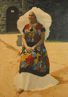 La Tehuana Oaxaca  This is a photo of an old photograph displayed in the post office in the city of Oaxaca, Mexico. It shows a woman (a model most likely) wearing a huipil and skirt . She also wears the magnificent headdress which is actually the lace hem of a child's dress.