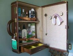Vintage suitcase turned wall cabinet...cute!