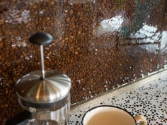 The backsplash for the bar was made with coffee beans!