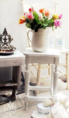 vintage table transformed with chalk paint |love the bright flowers in the all white setting