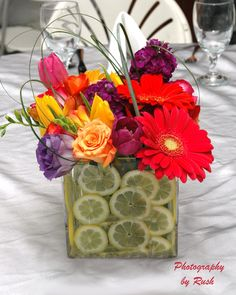 Kind of obsessed with the fruit + flowers centerpieces...