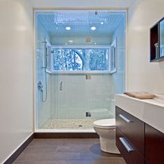 love the huge window and the tile work in this shower