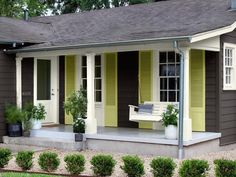 body color is basically a gray/brown (BM Iron Mountain) the shutters painted BM Pale Avocado