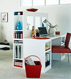 Think in 3-D  Rather than shoving your desk against a wall, make use of its every dimension. This stylish yet functional combination creates both a room divider and a three-sided storage solution with space for exposed media items and works of arts.