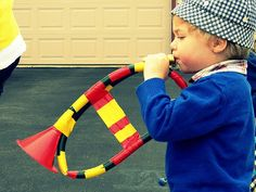 musical instruments- horn from plastic tube and plastic funnel