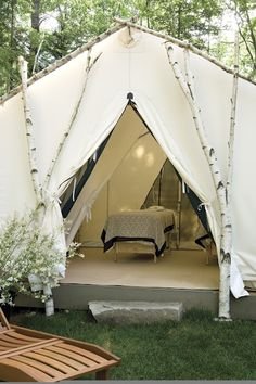 Massage Tent, this just seems so fun.  :D  I love everything about it... out doors, white tent and linens, organic