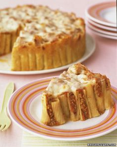 Baked Rigatoni Cake.  Butter a 9-inch springform pan. Toss pasta with Parmesan cheese. Tightly pack pasta into pan, standing each piece on end.