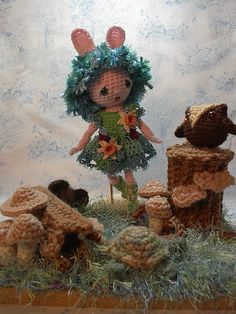 Spirit of Spring and a crocheted Fairy Garden.  Her dolls and clothing are beautiful and she has free PDF patterns.  The fairy in this picture is her Mini Pocket Spirit Doll. Great site for  anyone who loves crochet and dolls! http://byhookbyhand.blogspot.com/