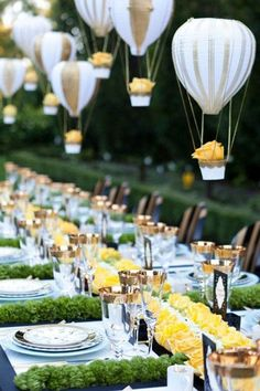 """Hot air balloon """"centerpieces"""" hanging over reception table"""