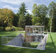 tiny house in the ground - I cant tell if this is CGI or a real-world example, but it's an amazing design for a partially underground home in either case