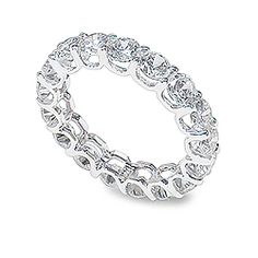 "Unity Rounds ""U"" Prong Swoop Setting CZ Eternity Band: Unity dazzles with an eye-catching ""U"" shaped swoop shared prong setting. Unity looks great alone or stacked with other bands! Available in 14K white gold or 14K yellow gold."