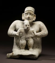 """Mother and Child - A mother proudly supports her male child who, with her help, stands securely on her lap. The Walters Art Museum in the special exhibition """"Exploring Art of the Ancient Americas: The John Bourne Collection Gift."""" http://art.thewalters.org/detail/80170/mother-and-child/"""
