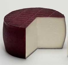 #Spanish ·wine #cheese. Queso de Murcia al Vino Protected Denomination of Origin 250 g.  Pressed, washed, uncooked cheese made from Murcian goats' milk. Macerated in red wine during ripening to give the rind the characteristic color and aroma. A pleasantly sharp aroma and unsalty flavor. The red wine in which the cheese is soaked during ripening gives a flowery aroma and a pleasant aftertaste with reminiscences of goat's milk and cream. The texture is creamy and elastic. #food  €6.00