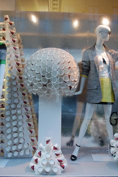 Recyclable cups at Diane Von Furstenberg create these delicate shapes in the window. #millinery #judithm #windowdisplay