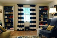 Navy and white striped curtains.