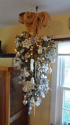 Upside-down Christmas tree hanging like a chandelier ! Love it.  From JunkSituation and she has great ideas !