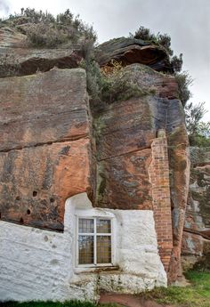 Holy Austin Rock, Kinver, Staffordshire, England. Homes in the rock. From the 1600's until the 1960's whole families lived comfortably in cave dwellings hewn into the soft sandstone along Kinver Edge. The rock houses here at Holy Austin Rock are among the finest in Europe.