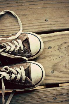 Brown converse on wood