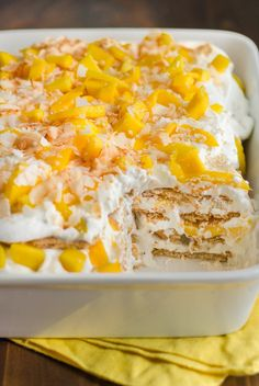 Mango Coconut Icebox Cake: 3/4 cup unsweetened coconut flakes 8 ounces cream cheese, softened at room temperature for 1 hour 15-ounce can sweetened cream of coconut, such as Coco Lopez 3 cups heavy cream 1 tablespoon rum, optional 24 to 28 whole graham crackers (4 sleeves, about 19 ounces) 5 large mangos, peeled and chopped (5 to 6 cups) 2 tablespoons turbinado sugar, optional