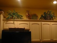 Decor above kitchen cabinets
