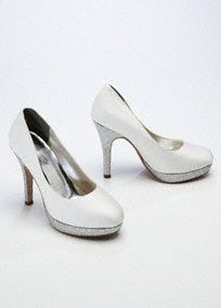 "Davids bridal. Glitter closed toe platform pumps.  Heel measures 4 1/4"". Platform measures 1/2"".  Available in Ivory.  Fully lined. Imported."