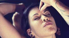 "[""Woman Touching Her Third Eye With Hand Mudra."" on Shutterstock]"