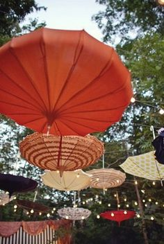 """""""DIY Hanging Umbrella Decor – Depending on your wedding theme or style, hanging a collection of umbrellas or parasols upside down creates an amazing view. {DIY Tip} Suspend paper parasols, vintage or funky umbrellas upside down along a line and add a few strings of lights"""""""