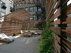 A different take on trellis use for shade:  TANK ROOFTOP - Exterior Views  Ipe wood boards (sustainably harvested) wrap around the roof terrace on various trellis structures. Integrated bench sits at far side of photo. Industrial fans that required acoustical buffer are at top left of photo.