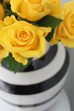 black white striped vase with yellow roses