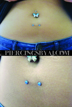 Healed 14g lower navel surface piercing with 4mm prong set blue opal gems. Jewelry from Anatometal.